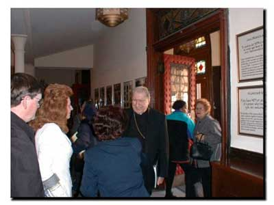 Picture of Cardinal O'Connor entering St. Cecilia's Church and greeting parishioners