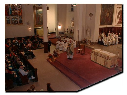 Picture of Cardinal O'Connor speaking to those gathered for the Mass Celebration